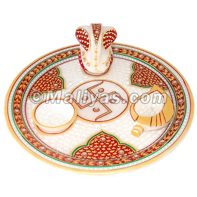 Marble puja thali with ganesh and deyas