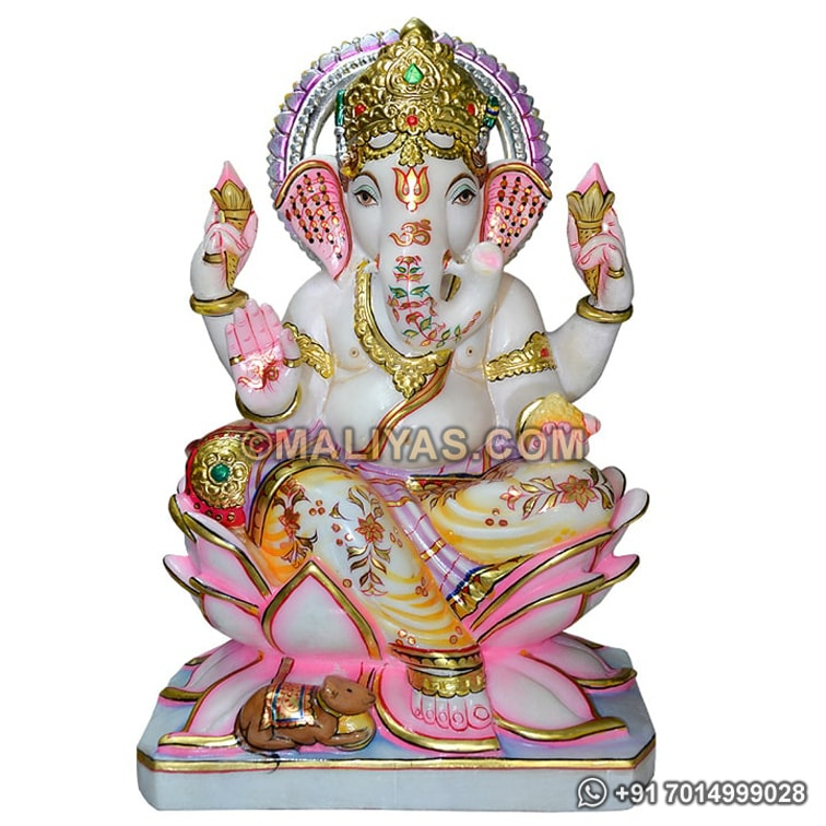 Marble Ganesh statue sitting on lotus